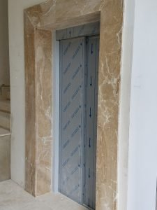 elevator's doors framed in marble